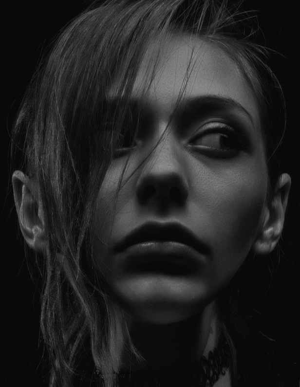 grayscale photography of woman looking sideways