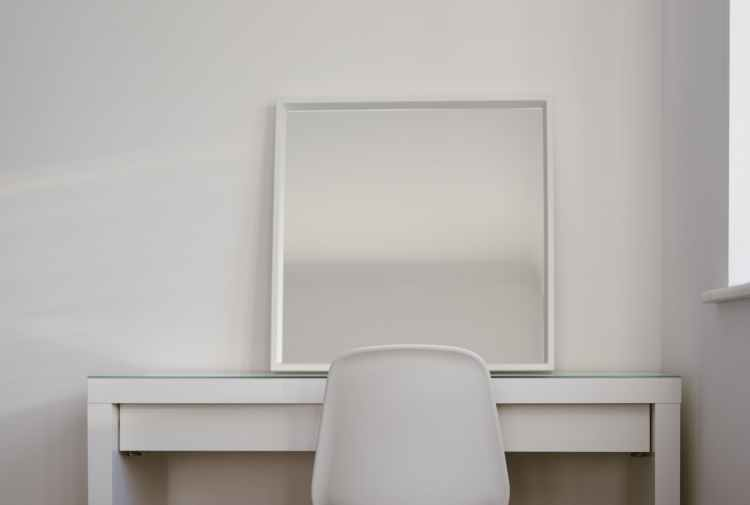 chair in front of desk with mirror on top